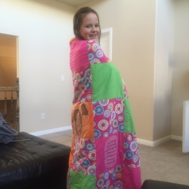 Miss Megan Lovin' her Gma Keri made quilt!